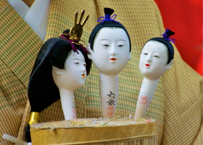 Ando doll faces in Kyoto, Japan