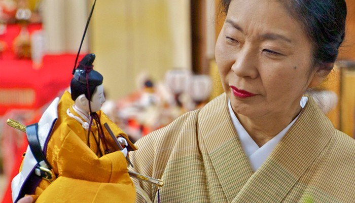 Mrs Ando in Kyoto, Japan gazing at an Emperor doll