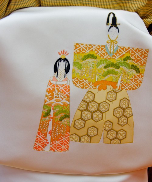 Mrs Ando's obi belt with Ando dolls in kimonos on it in Kyoto, Japan