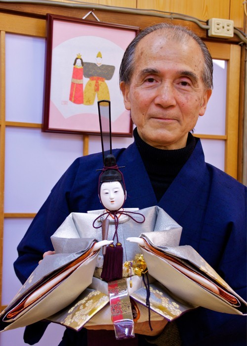 The creator, Ando, with one of his Emperor dolls in Kyoto, Japan