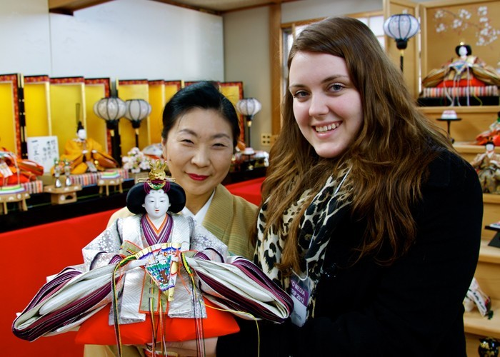 Nicole and Mrs Ando holding an Empress doll in Kyoto, Japan