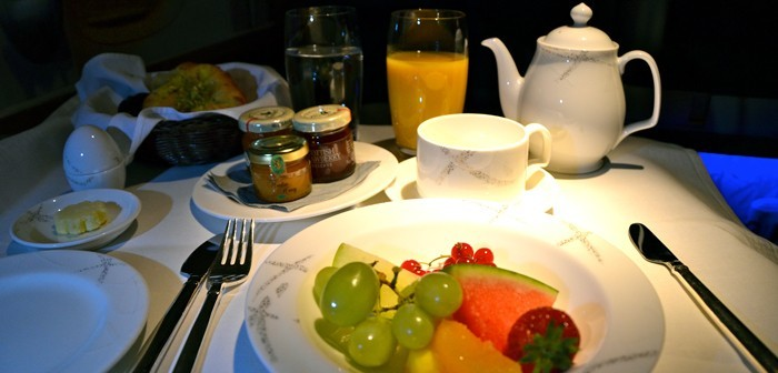 Dining in Cathay Pacific's first class is delicious and begins with a fruit salad and tea