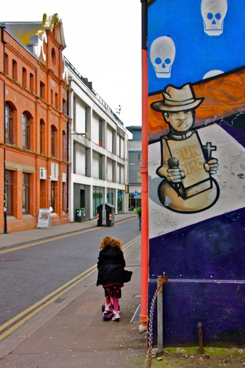 Street art and street with girl of a chess piece in Kensington Place, Brighton