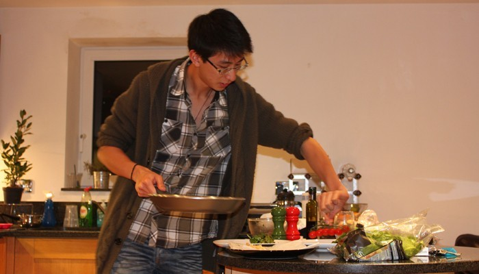 Dylan Lowe from the Travelling Editor cooking dinner for me in 2010