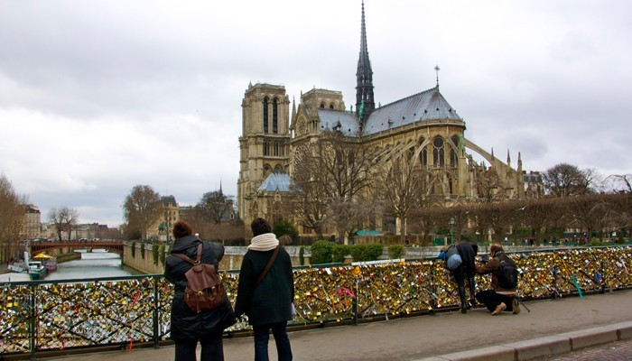 Pont de l'Archevêché overlooking the Notre Dame church in Paris France with love locks